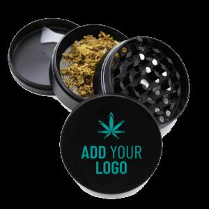 Custom 4 piece metal black grinder with a custom branded logo ground cannabis and a scraper